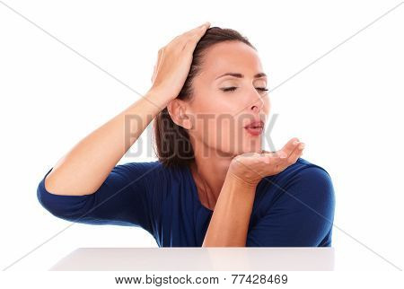 Young Brunette With Closed Eyes Blowing A Wish