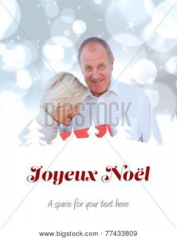 couple with shopping bag against joyeux noel