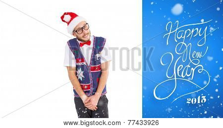 Geeky hipster in santa hat against blue vignette