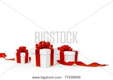 White gift boxes with red ribbon bows isolated on white background close-up