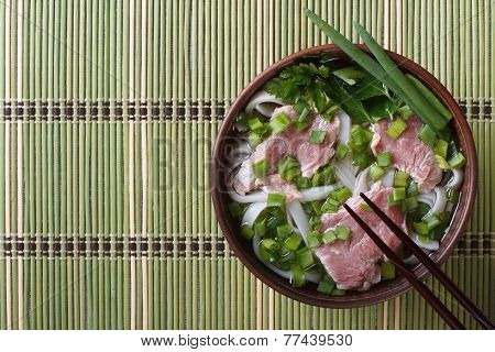 Vietnamese Pho Bo Soup With Beef Rare, Rice Noodles And Fresh Herbs