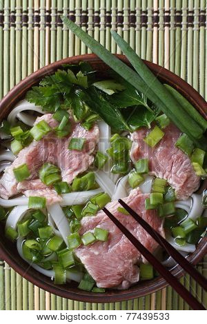 Vietnamese Pho Bo Soup With Beef Rare Closeup. Top View