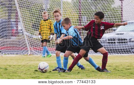 A Group Of Youth Soccer Players Compete