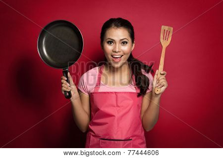 Excited Female Chef Or House Wife Ready To Cook