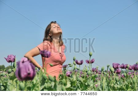 Young Woman In Field Of Poppies