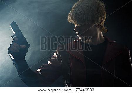 man with a gun in hand