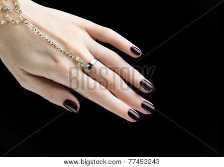 Manicured Nail With Black Matte Nail Polish. Manicure With Dark Nailpolish Isolated On Black Backgro