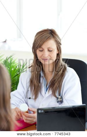 Delighted Female Doctor Pointing Radiography