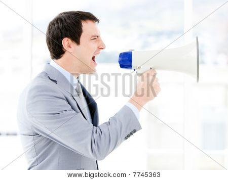 Portrait Of An Pretty Businessman Using A Megaphone
