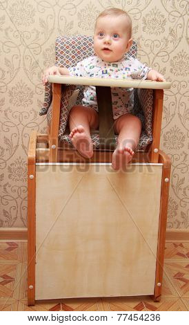 adorable baby on highchair, at home