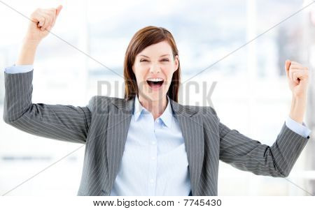 Positive Businesswoman Punching The Air