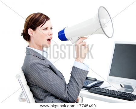 Portrait Of An Angry Businesswoman Using A Megaphone