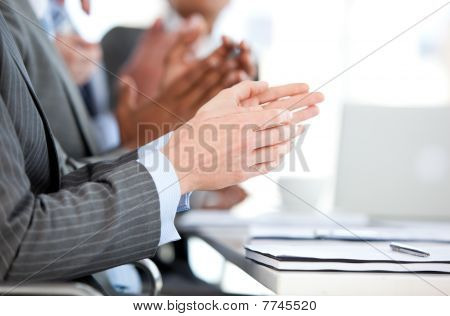 Close-up Of A Businessteam Applauding A Presentation