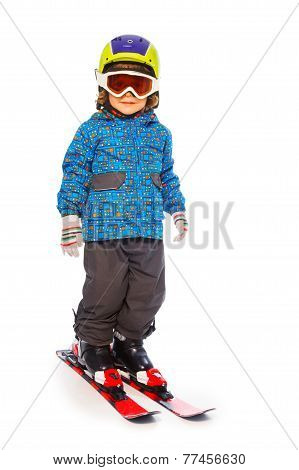 Boy stands wearing mountain skies isolate on white