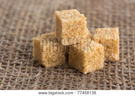 Cubes Of Brown Sugar On Jute Bags