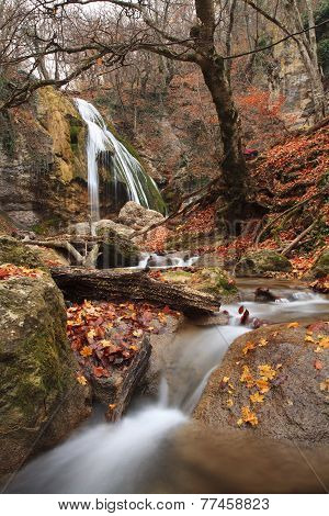 Waterfall In The Autumn Forest