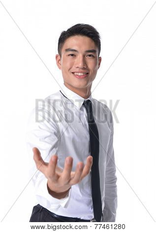 Businessman in a suit holds out his hand with the palm facing upwards isolated