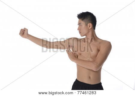 Young sportsman, fitness muscle model guy making bodybuilding exercise isolated on white. Concept of sport, health