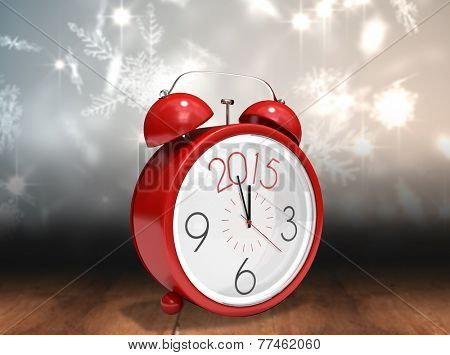 2015 in red alarm clock against shimmering light design over boards