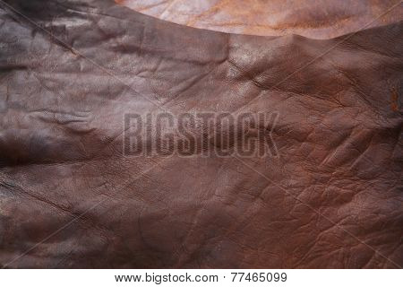 Processed raw hide or leather placed on leather working table. (not a texture shot, has depth)