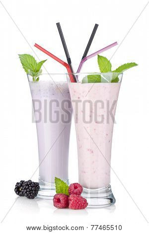 Blackberry and raspberry milk smoothie with mint. Isolated on white background