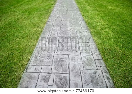 Stone walkway on a grassy field