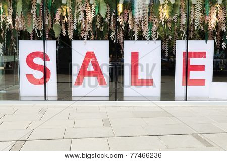 sale poster in the fashion shopfront