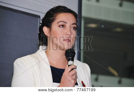 HASTINGS, ENGLAND - NOVEMBER 10, 2014: Sarah Owen, Labour party Parliamentary Candidate for Hastings and Rye, speaks at an energy policy meeting. The next General Election will be held in May 2015.