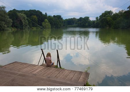 Sad Girl On A River Bank