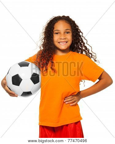 Little African girl holding soccer ball isolated