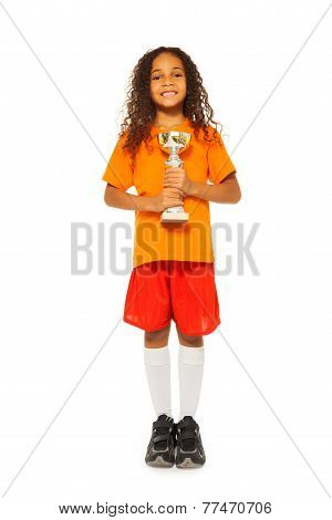 Little African girl with prize cup in sport game