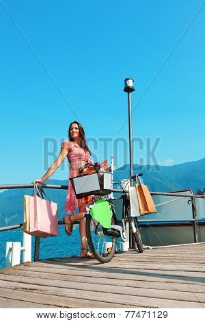 pretty girl with shopping bags going shopping, external