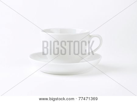 empty coffee cup and saucer on white background