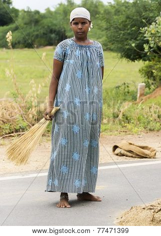 Young Teen-aged Girl In Traditional Dress Helps With Millet Harvest.