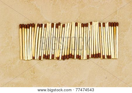 match sticks kept under sunlight for drying on a plain background