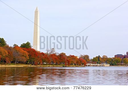 National Monument with trees around the Tidal Basin in autumn foliage.