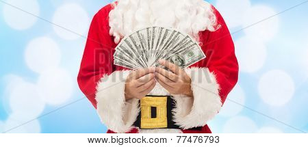 christmas, holidays, winning, currency and people concept - close up of santa claus with dollar money over blue lights background
