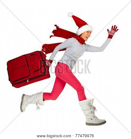 Happy Santa woman running with suitcase. Vacation.