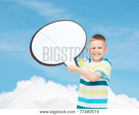happiness, childhood, conversation and people concept - smiling little boy with blank text bubble over blue background