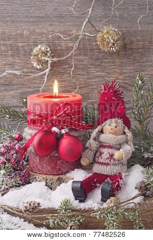 Christmas red candle and winter decoration