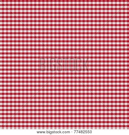 table covered by red checkered tablecloth or gingham cloth