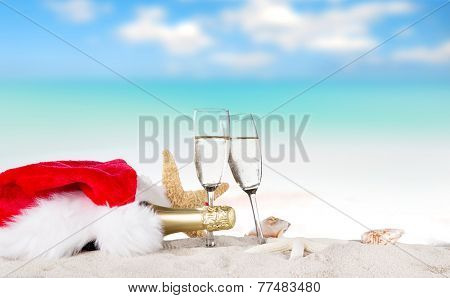 Champagne flutes on sunny beach, celebration theme.