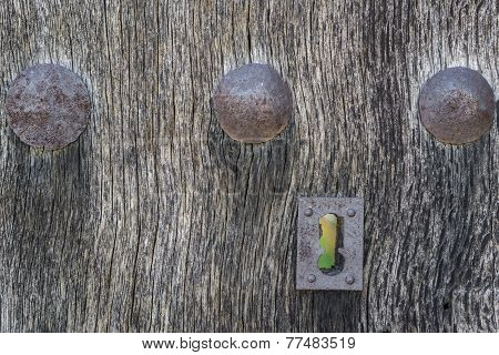Old run-down wooden door and lock