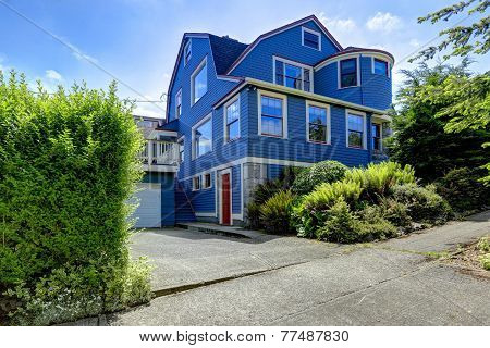 Big House Exterior In Blue Color With Red Trim