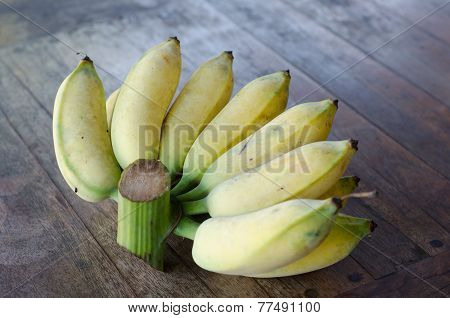 Musa Sapientum Banana On Wooden Table