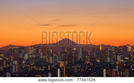 View of Tokyo city and Mountain Fuji with Tokyo Tower at sunset