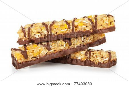Bar With Grains And Nuts And Chocolate On Isolated White