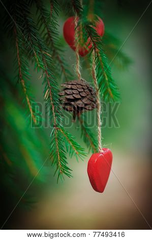 Christmas Background With Fir Cone And Heart On The Fir Branch
