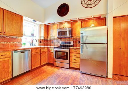 Maple Cabinets And Steel Appliances