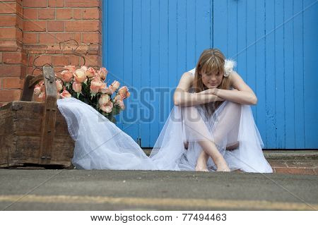 Young beautiful woman relaxing outdoors against blue door